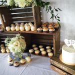 Cake and cupcakes with wooden crates